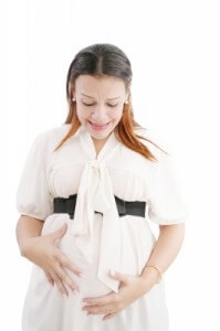 Pregnant woman feeling discomfort