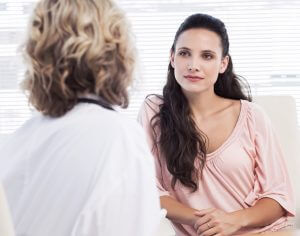 Female patient listening to doctor