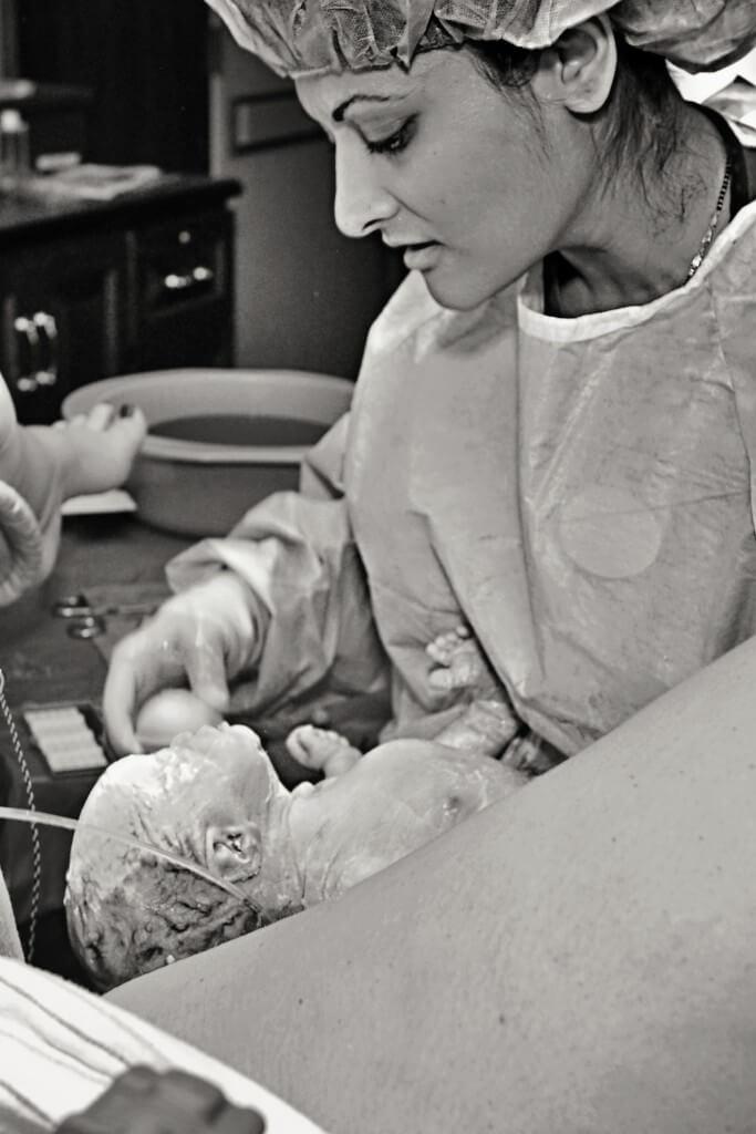 Dr. Gandhi delivering baby