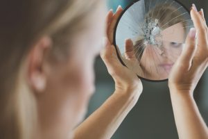 woman-looking-in-mirror-photo