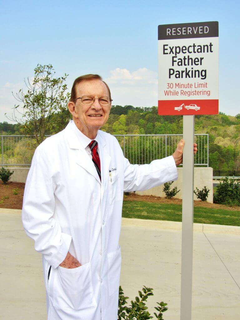 Dr. James Cross smiling at Dad-friendly parking.