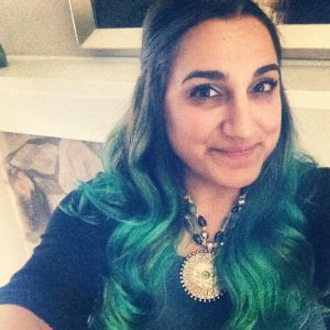 Sherene gets the word out about Ovarian Cancer Awareness with teal hair.