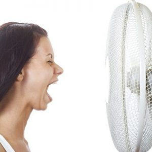 perimenopausal woman with hot flash photo